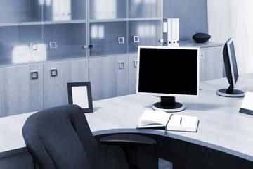 monitors on a desks in office