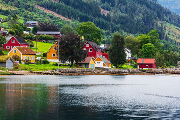 Reflection of houses in a norwegian fjord