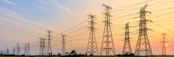 high-voltage power lines at sunset,high voltage electric transmission tower