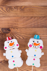 Marshmallow snowmen on stick, place for text