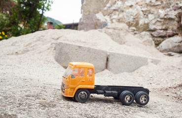 Yellow Toy truck on the sand