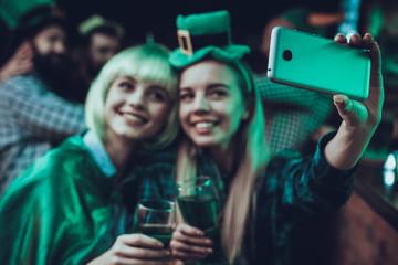 Friends doing selfie at Saint Patrick's Day at pub