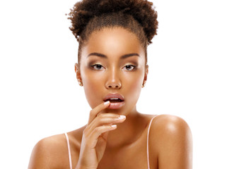 Attractive young woman touching her lips. Photo of african woman finishes makeup on white background. Youth and skin care concept