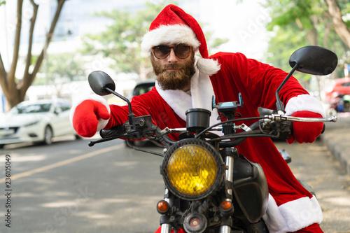 Biker Christmas.Serious Handsome Christmas Biker Posing On Motorbike