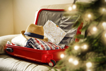 red suitcase and christmas tree decoration