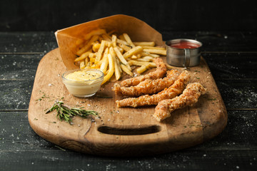 French fries with nuggets with salt and rosemary