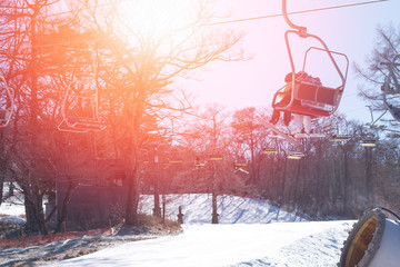 White snow mountain background of ski slope mountain in winter resort with people in vacation skier and snowboard with ski lift chairs gondola