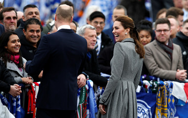 Britain's Prince William and Catherine the Duchess of Cambridge greet well wishers after viewing tributes to Leicester City's owner Thai businessman Vichai Srivaddhanaprabha, outside Leicester City's King Power stadium in Leicester