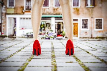 Slim woman legs and street background