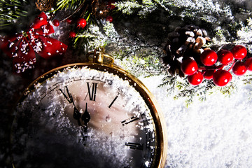 New Year clock powdered with snow.