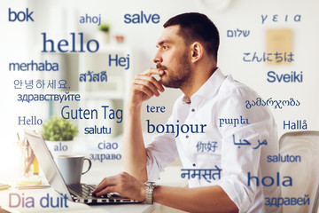 translation, business, and technology concept - male translator or businessman with laptop computer...