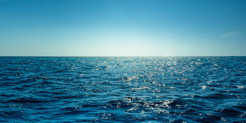Blue ocean panorama with sun reflection, The vast open sea with clear sky, Ripple wave and calm sea...
