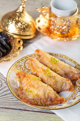 Turkish traditional Dessert Baklava with tea on dark background. Fresh and healthy dessert.