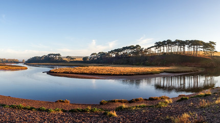River Otter tidal lagoon at high tide with reflections, The Jurassic Coast World Heritage Site, Budleigh Salterton, Devon