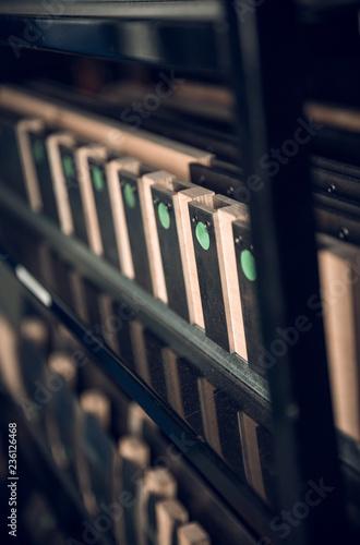 Vintage lead letterpress printing blocks against a weathered metal