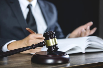 Legal law, Judge gavel with Justice lawyers advice with gavel and Scales of justice, Counselor or Male lawyer working on courtroom sitting at the table and papers