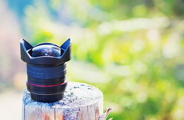 Camera lens in natural outdoor, vintage look, copy space