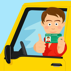 Young happy boy showing his new driver license sitting in his car