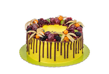 Colorful delicious cake with fruit and poured chocolate.