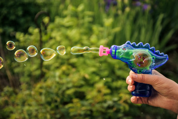 Image of toy gun shooting bubbles