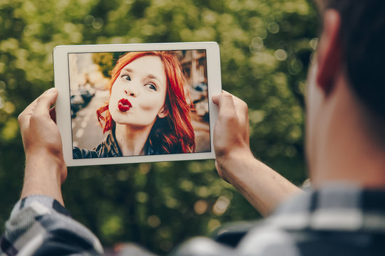 Young couple in love chatting over a video call, by using a tablet.