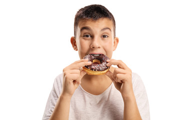 Young boy biting a donut