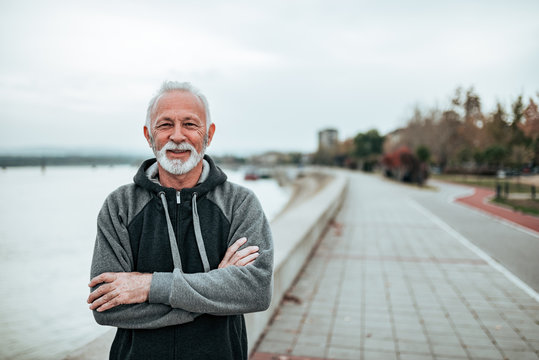 Portrait of a active senior in sportswear by the river.