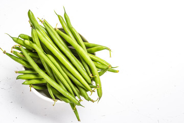 Green beans on white background.