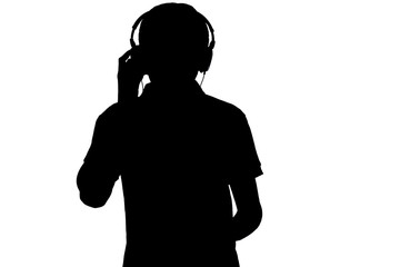 music lover silhouette in headphones on white isolated background, teenager boy enjoying favorite...