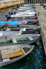 A Fleet of Rowboats Tenders Small Motor Boats at Dock