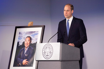 Britain's Prince william speaks next to a picture of,  Leicester City's owner Thai businessman Vichai Srivaddhanaprabha's during a visit to Leicester City's King Power stadium, in Leicester