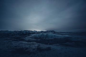 Dark landscape of snowy valley