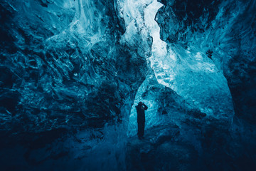 Man in beautiful blue ice cave