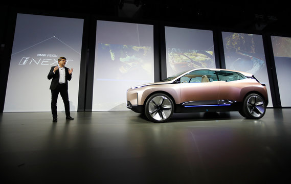 Klaus Frohlich, member of the Board of Management of BMW AG, Development, introduces the BMW Vision iNEXT electric autonomous concept car during a BMW press conference at the Los Angeles Auto Show in Los Angeles