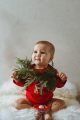 A little girl with a fir tree. Prepare for Christmas.