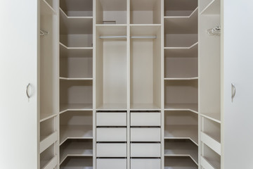 Modern closet in the hotel for different needs and clothes.