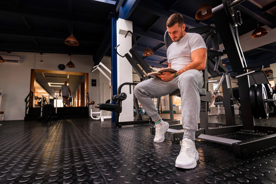 Fitness trainer writes workout plan close up in gym