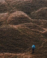 Man climbing up a hill