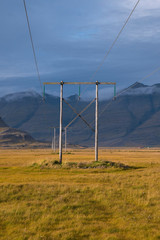 Sunset and power lines in Icelandic landscape