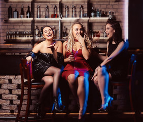 Cheerful female friends resting in the nightclub