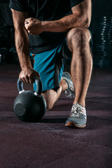 Kettlebell training in gym. Athlete doing workout