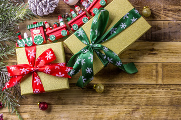 Christmas background with decorations and gift boxes on wooden background. Top view