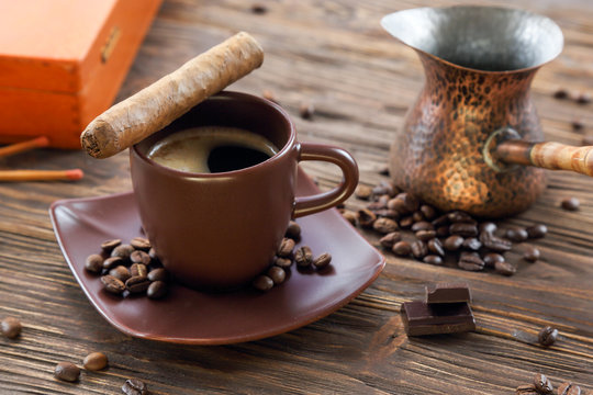 Cigar, chocolate and a cup of black coffee