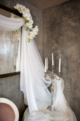 wedding vintage decor with veils, candles and orchids - vertical orientation