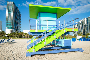 Brightly colored lifeguard tower standing empty in sunrise light on South Beach, Miami, Florida, USA
