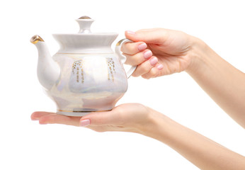 Tea pot in hand on a white background. Isolation