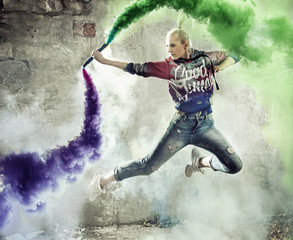 Flexible girl dancer holding a colorful flare
