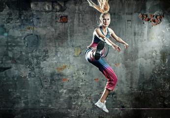 Foto auf AluDibond Artist KB Blonde athlete lady in a jump pose