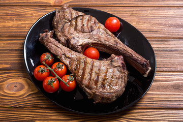 Grilled beef tomahawk steak