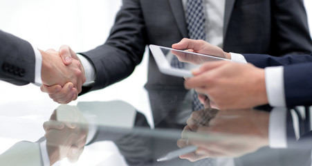 close up.handshake of new business partners